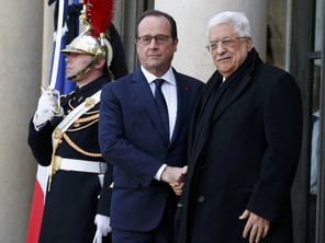 French President Francois Hollande welcomes Palestinian President Mahmoud Abbas at the Elysee Palace before attending a solidarity march in the streets of Paris