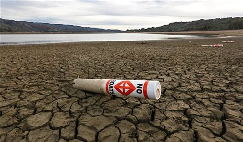 A warning buoy sits on the dry, cracked bed of Lake Mendocino near Ukiah, California. (AP Photo/Rich Pedroncelli, File)