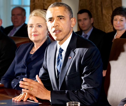 This Nov. 28, 2012 file photo shows then-Secretary of State Hillary Rodham Clinton listening as President Barack Obama speaks in the Cabinet Room at the White House in Washington. (AP Photo/Jacquelyn Martin, File)