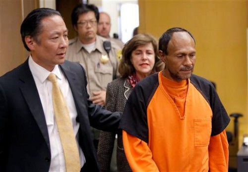 In this Tuesday, July 7, 2015 file photo, Juan Francisco Lopez-Sanchez, right, is lead into the courtroom by San Francisco Public Defender Jeff Adachi, left, and Assistant District Attorney Diana Garciaor, center, for his arraignment at the Hall of Justice in San Francisco. More than 1,800 immigrants that the federal government wanted to deport were nevertheless released from local jails and later re-arrested for various crimes, according to a government report released Monday, July 13, 2015. (Michael Macor/San Francisco Chronicle via AP, Pool, File)